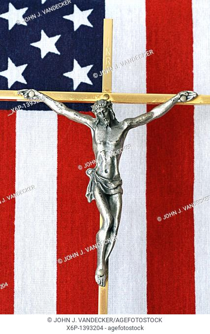 A Crucifix with an American flag in the background  This Crucifix lay on the casket of an American War Veteran