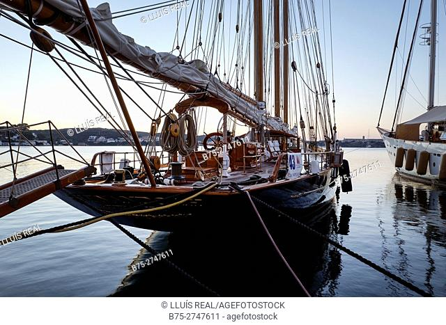 Moored vintage sailboat in the early morning. Port of Mahó, Minorca, Balearic Islands, Spain