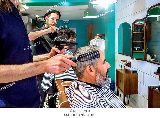 Barbers working in barbershop