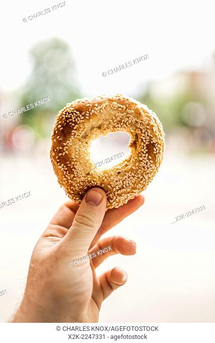Holding an Authentic Montreal bagel in hand