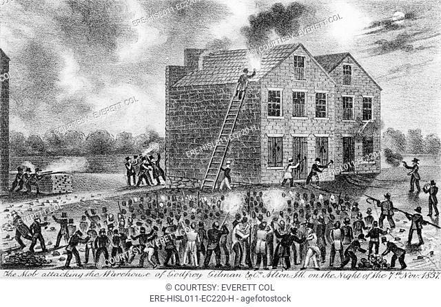 A Pro-slavery mob burning down the building housing the newspaper of abolitionist Elijah Parish Lovejoy 1802- 1837 on November 7, 1837