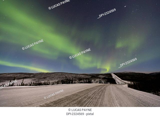 Northern lights dancing over the james dalton highway in winter north of fairbanks;Alaska united states of america
