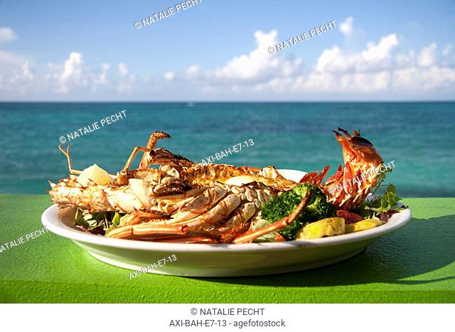 Lobster dish at Compass Point Resort Hotel restaurant, sea in the background