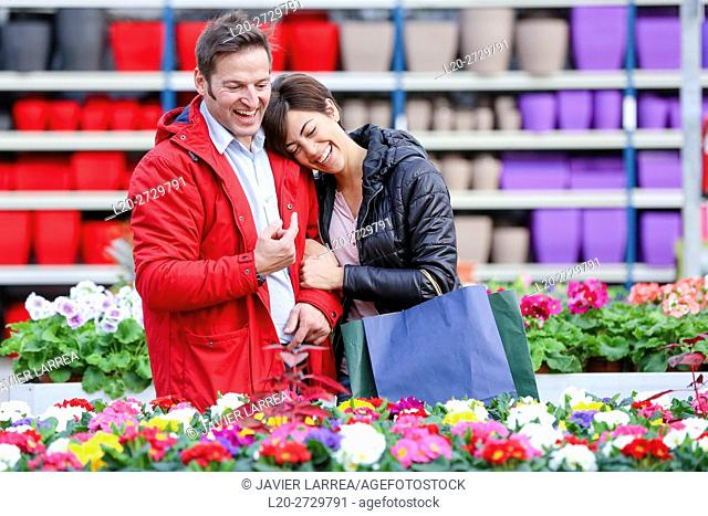 Couple buying flowers, garden center
