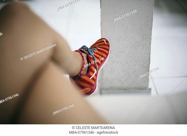 legs of a girl waiting with sport shoes