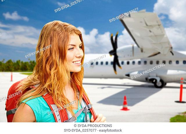 tourist woman with backpack traveling by plane