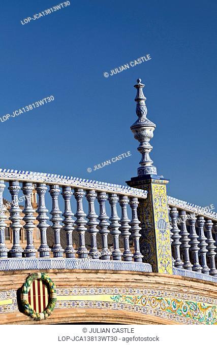 Spain, Andalucia, Seville. Bridge decorated with ceramic azulejo tiles at Plaza de Espana