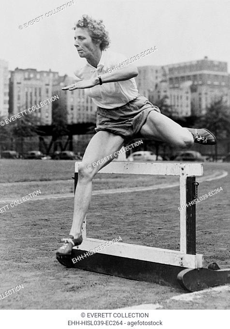 Fanny Blankers-Koen clearing a low hurdle at McCombs Dam Park in the Bronx, 1949. The Dutch athlete won four gold medals at the 1948 Summer Olympics in London