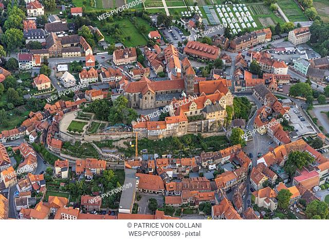 Germany, aerial view of Quedlinburg with collegiate church in the evening