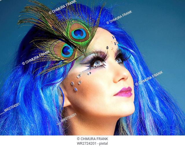 Portrait of a Woman in Blue Wig and Peacock Feathers