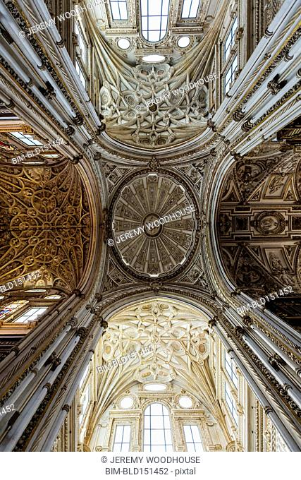 Low angle view of roof and ornate arches in mosque, Cordoba, Andalusia, Spain