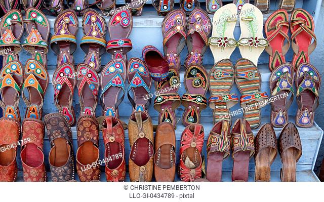 Display of traditional Indian shoes and slippers for sale in Agra, India