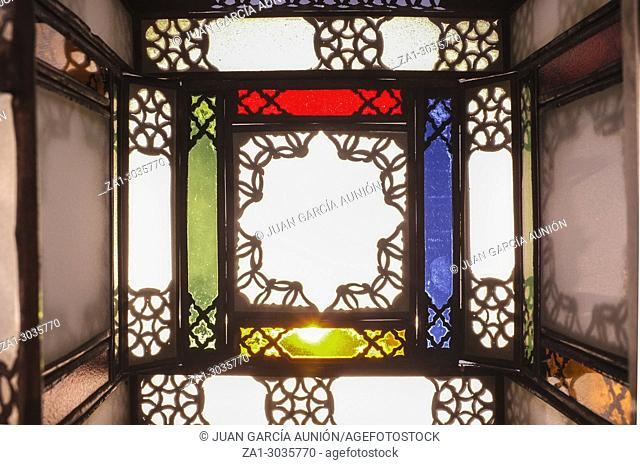 Colorful arabian lamp of metal and glass with star motive. Interior background