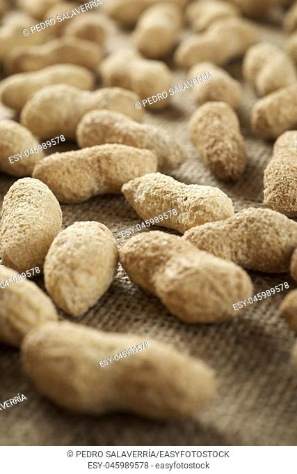 Peanuts with shell on a table
