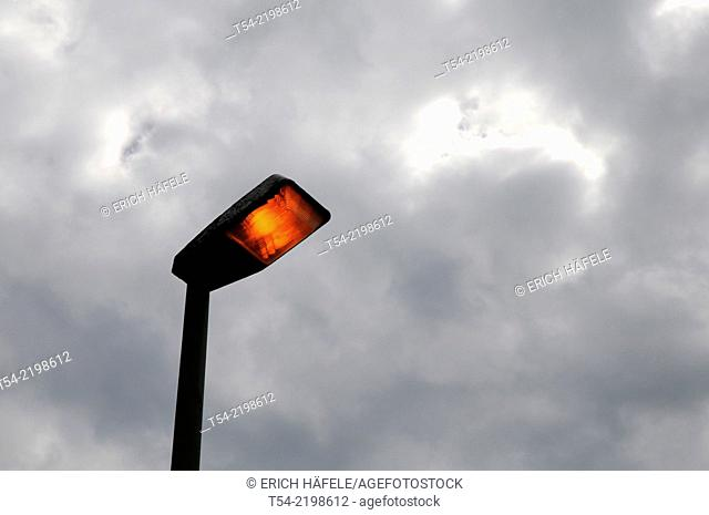 Streetlight lit on the day