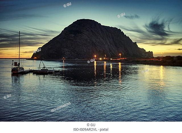 Silhouetted view of Morro Bay Rock at sunset, Morro Bay, California, USA