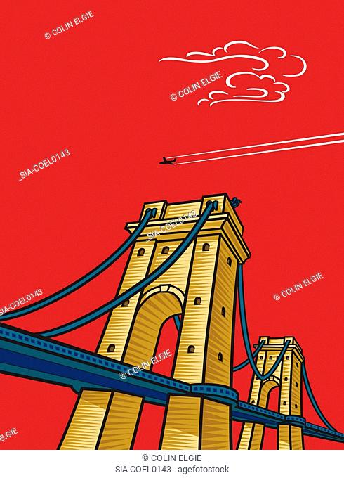 Low angle view of suspended bridge, airplane in red sky