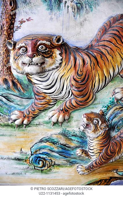 Malacca (Malaysia): decorative bas-relief with tigers on a temple's wall in Chinatown