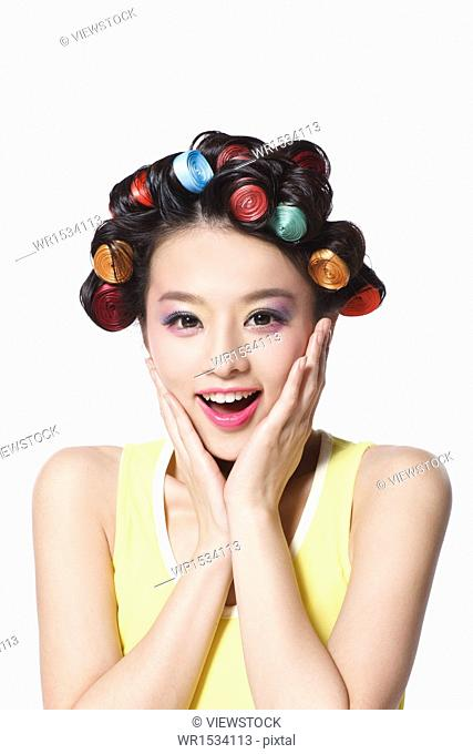 Oriental youth woman is a perm