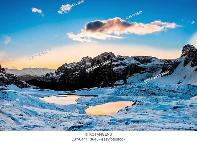Snow and mountain lake Lago dei Piani near Drei Zinnen or The cime, Italy Alps Dolomites