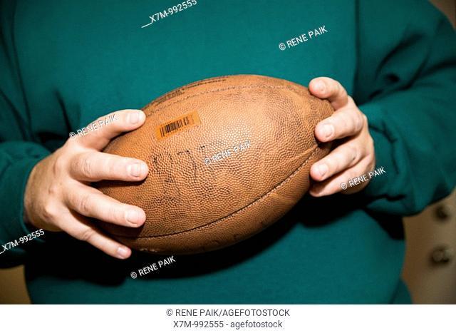 Man holds American football