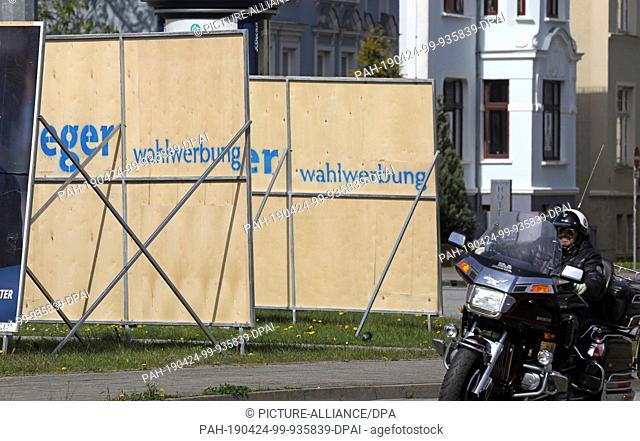 20 April 2019, Mecklenburg-Western Pomerania, Rostock: In front of the main station various parties have put up their election posters for the upcoming local...
