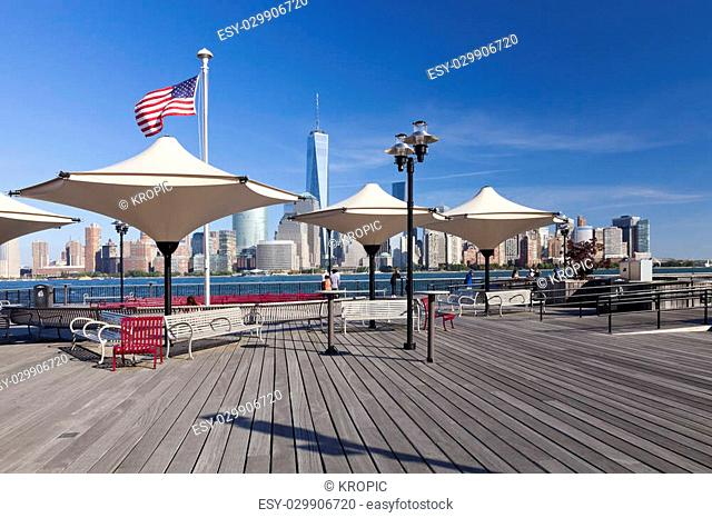 Jersey City, USA-October 3, 2014: Hudson River waterfront park at Exchange Place is named in honor J.Owen Grundy. Amazing view of the Freedom Tower and of lower...