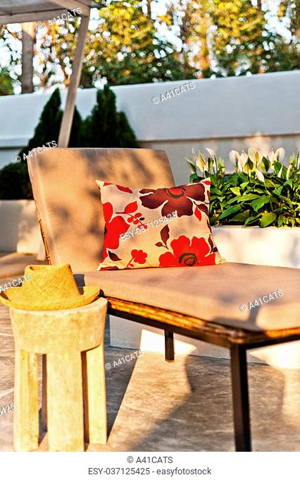 Villa garden with Sunlounger in the beautiful afternoon sun