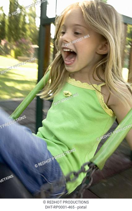 Father and Daughter in Park on swing