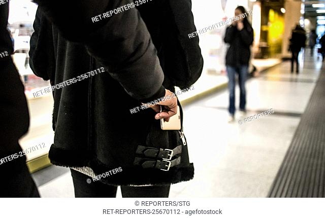 Belgium , Brussels , Jan 30, 2018 - ILLUSTRATION - Gare du Nord Brussels - Young woman gets her mobile phone stolen - Man stealing a wallet - Young woman at a...