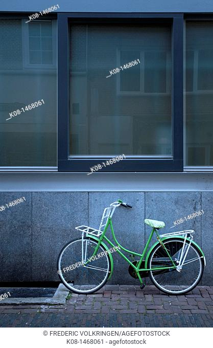 Green bicycle and facade, Utrecht, Netherlands