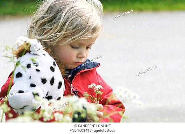 Close-up of girl picking flower
