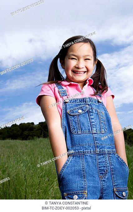 Young Asian girl smiling outdoors