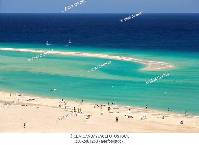 People surfing, sunbathing and swimming on Sotavento beach, Fuerteventura, Canary Islands, Spain, Europe
