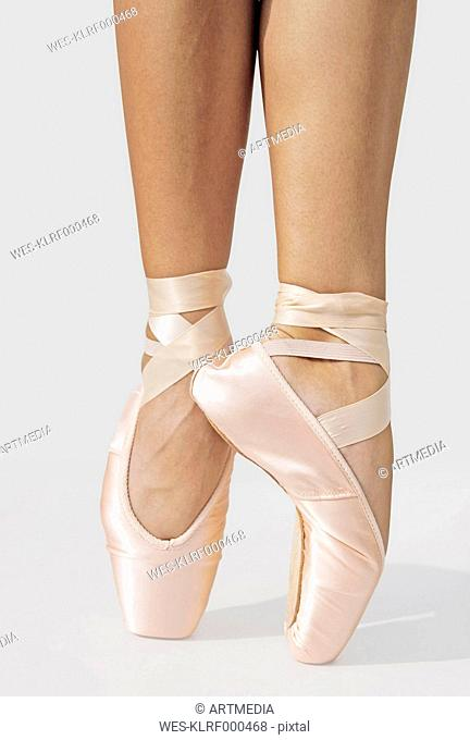 Ballerina standing on tiptoes, partial view