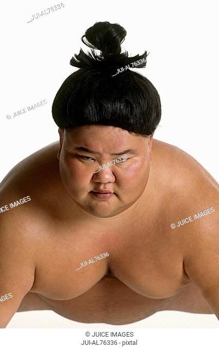 View of a sumo wrestler squatting