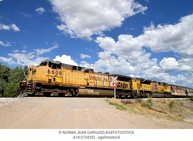 A freight train heads north from Nogales, Sonora, Mexico and passes through Tubac, Arizona, USA. Trains cross the international line from Mexico to transport...