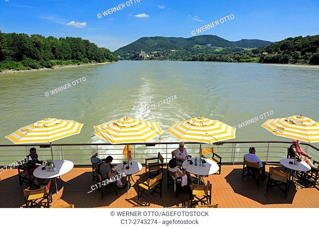 tourism, holiday, freetime, Danube river cruise, Danube navigation, open afterdeck on an aROSA cruiser, restaurant, dishes, chairs, sunshades