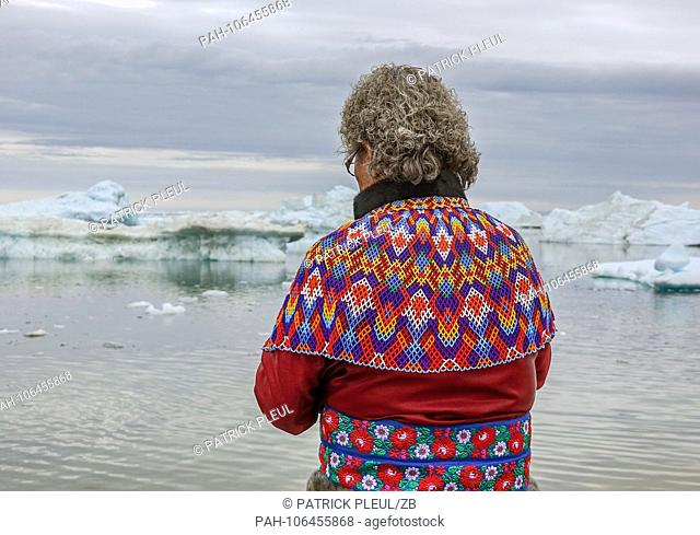 21.06.2018, Gronland, Denmark: An elderly woman is wearing national costume on July 21 in the coastal town of Ilulissat in western Greenland