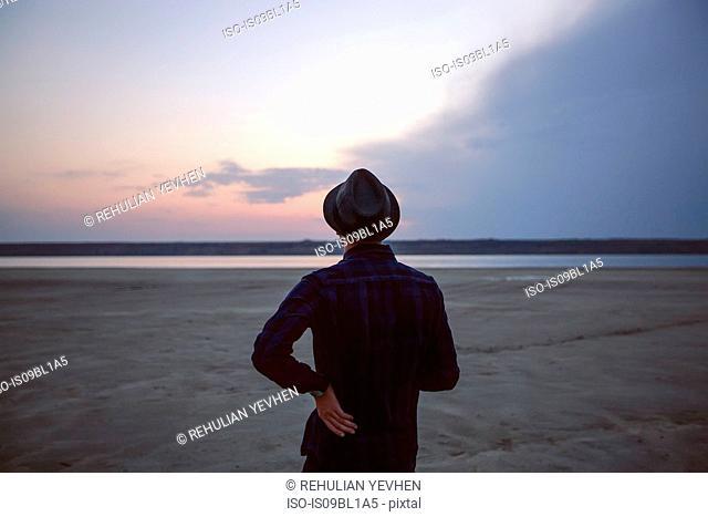 Man in hat on beach at sunset, Odessa, Ukraine