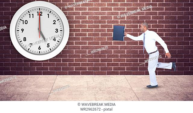 Businessman with briefcase running late with clock mounted on wall