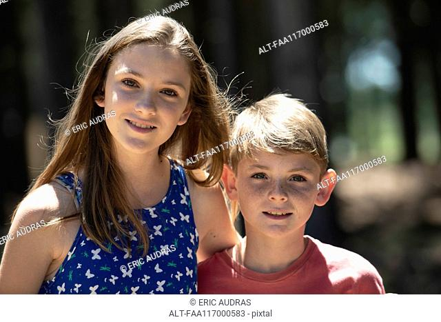 Close-up of brother and sister standing outdoors