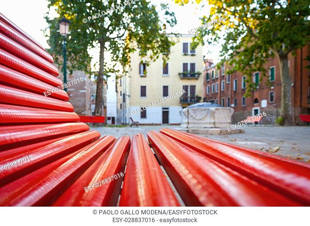 Unusual view of a traditional square in Venice from a bench