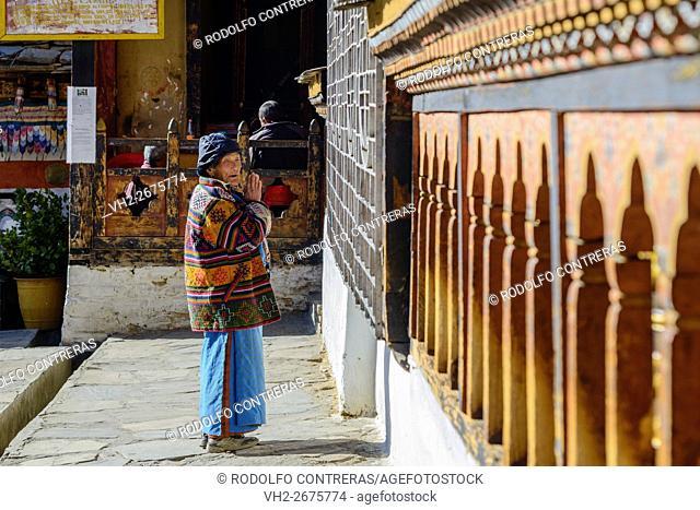 Woman praying at the monastery, Bhutan