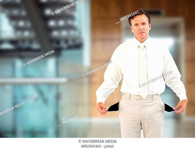 sad man with white suit and with empty pockets in front of the elevator