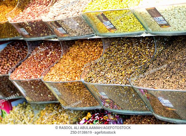 photo for Nuts Store in Mashhad city in Islamic Republic of Iran. it shows walnuts and hazelnuts and other kinds