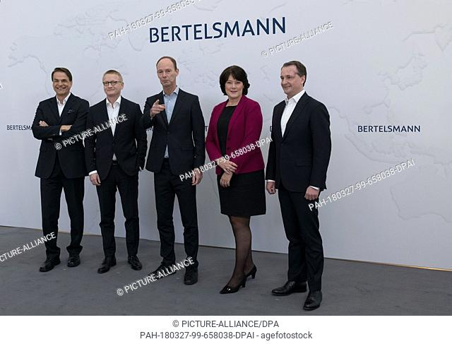27 March 2018, Germany, Berlin: The Bertelsmann board poses for photographers prior to a press conference: Markus Dohle (l-r