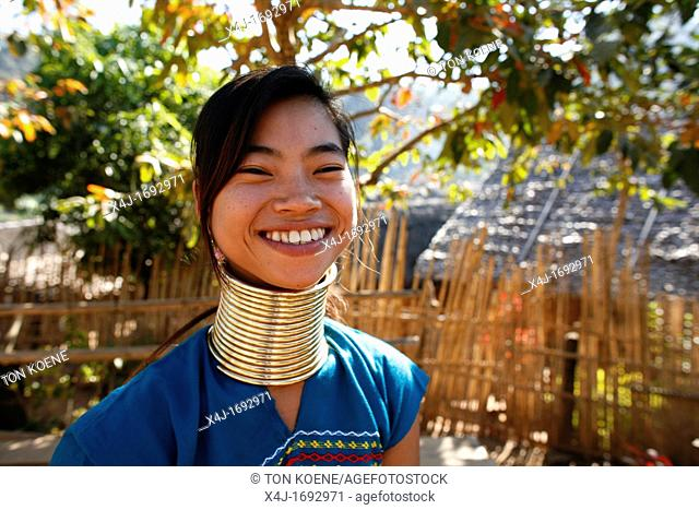 Smiling Longneck girl outdoors Approximately 300 Burmese refugees in Thailand are members of the indigenous group known as the Longnecks The largest of the...