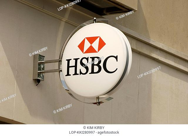 England, North Yorkshire, York, An HSBC bank sign mounted to a wall outside a branch of the bank