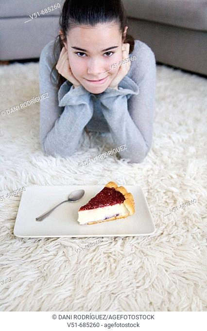 Teenage girl wanting to eat a cake